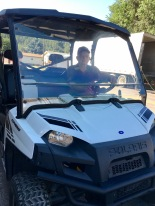 Bruce in a Polaris off-road vehicle